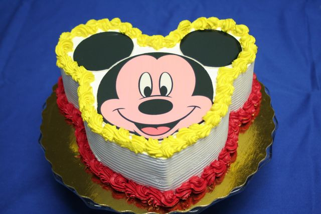 A Large Chocolate Disc Is The Basis Of Mickeys Smiling Face On This Cake Photo C Disney