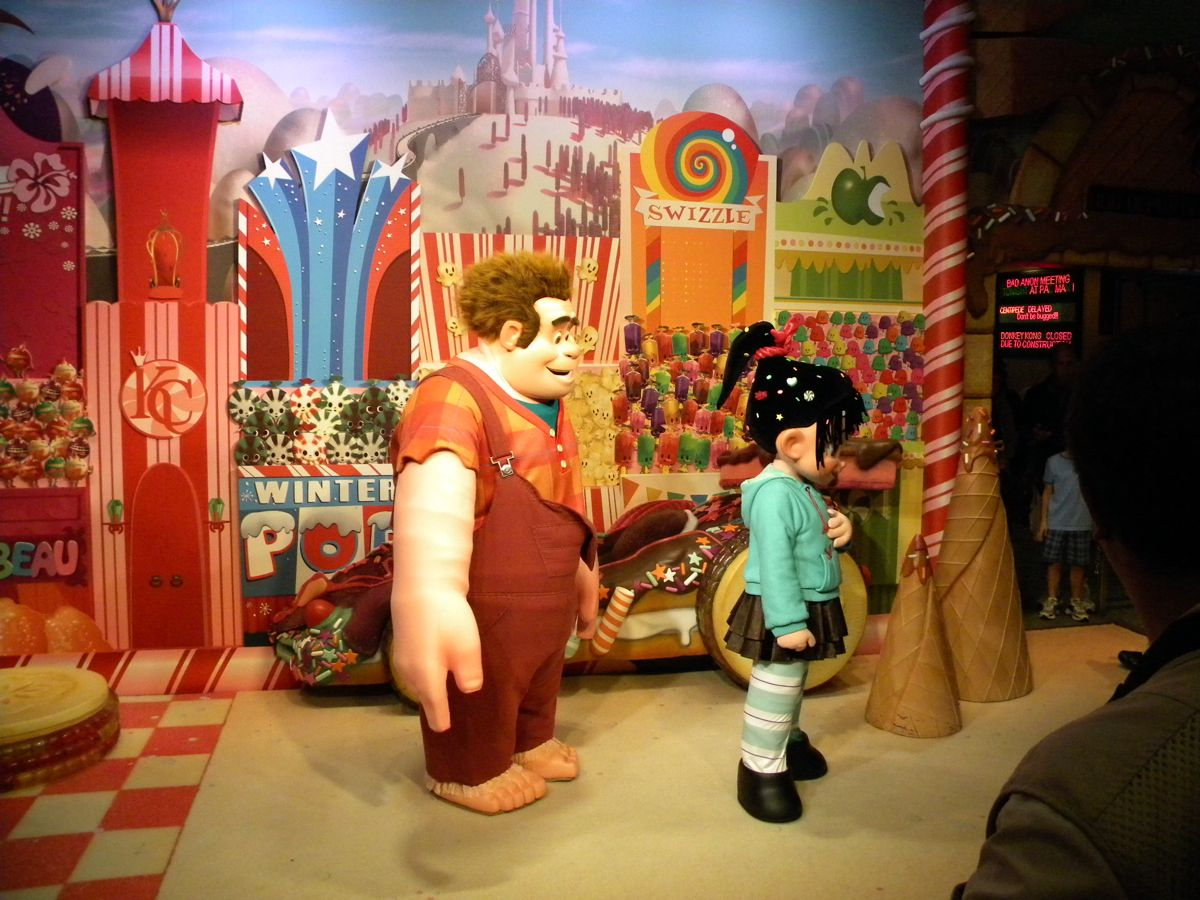 Mouseplanet my disney top 5 disney animated films that deserve ralph and vanellope greet guests at disneys hollywood studios the backgrounds and model car hint at just how awesome a full blown attraction could look kristyandbryce Choice Image