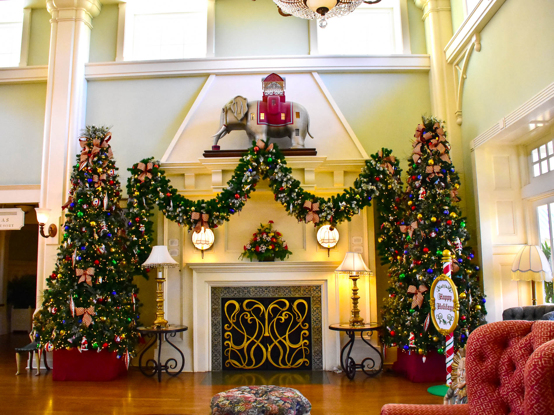 the fireplace mantel at disneys boardwalk inn is fully decorated for christmas photo by bonnie fink