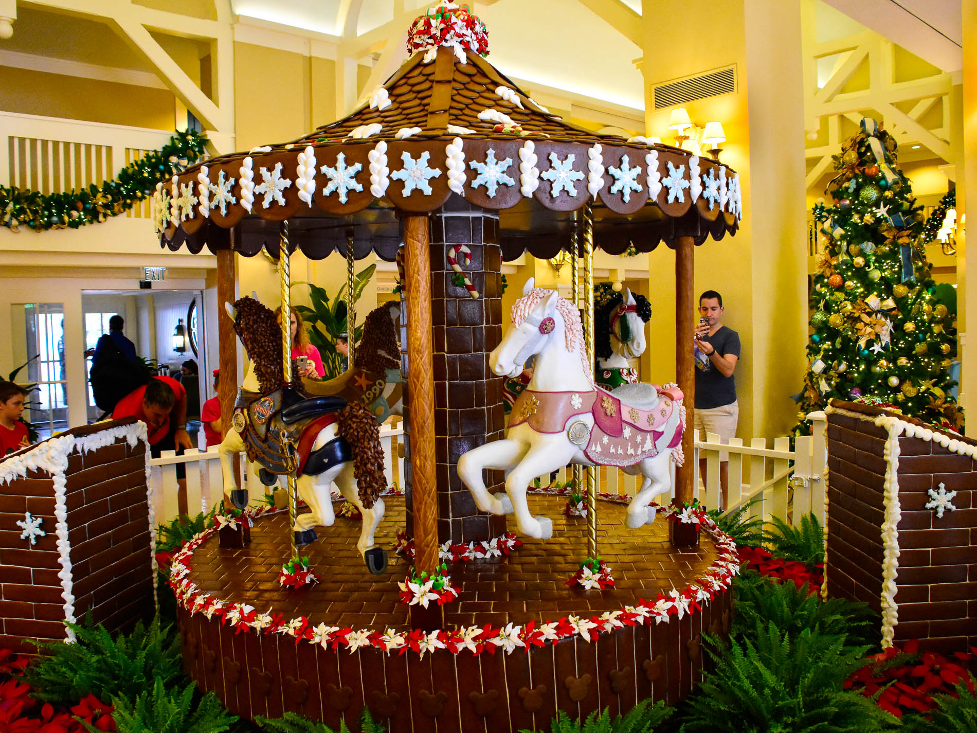 the gingerbread carousel consists of four horses as it slowly rotates you can try to pick out the sixteen hidden mickeys photo by donald fink - When Is Disney Decorated For Christmas