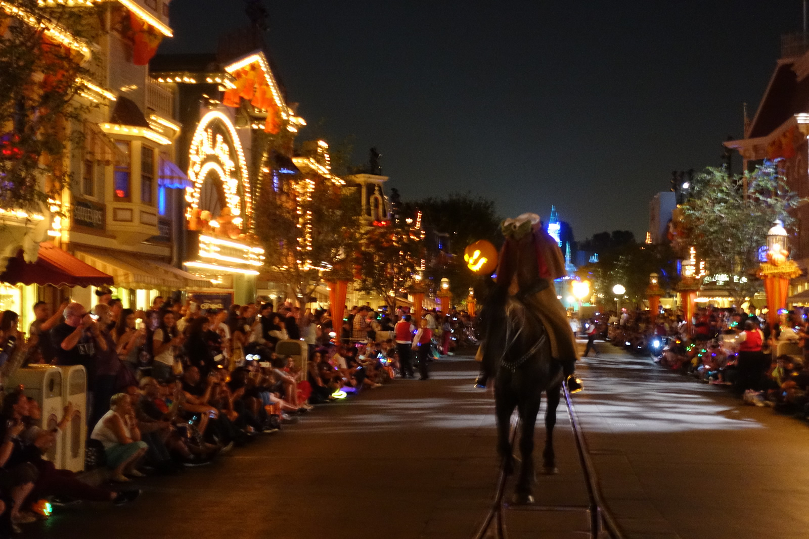 the headless horseman makes his way down main street before the premiere of the frightfully fun parade at mickeys halloween party