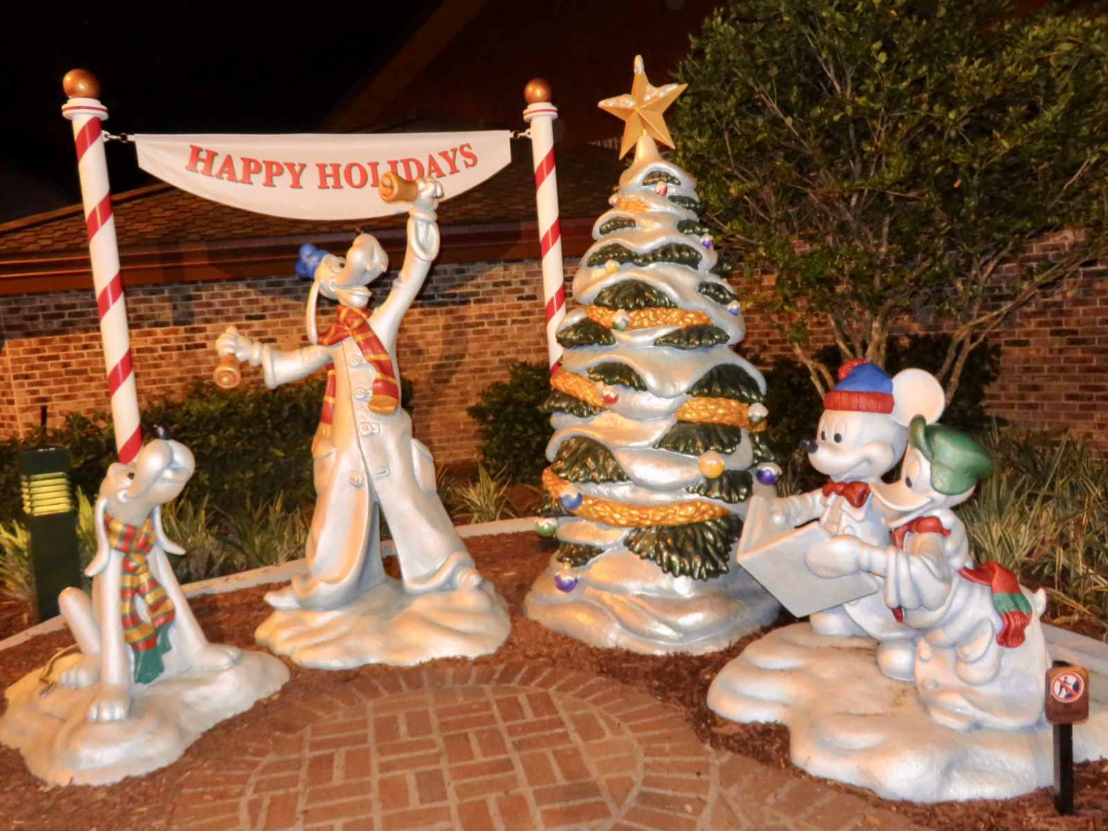 the happy holidays sculpture next to disneys days of christmas store - Disney Christmas Store