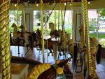 The restoration of the Congress Park Carousel was completed in 2002 after the closing of Kaydeross Park, where the antique wood
