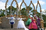 Cinderella thanks her court while Prince Charming holds her hand, at WDW's Cinderellabration. Photo by Lani Teshima