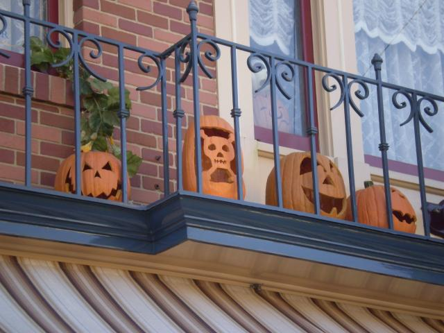 More cleverly-carved pumpkins on Main Street balconies. Photo by Shoshana Lewin.