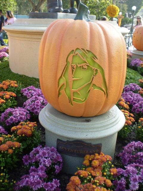 Pumpkins carved in character faces surround the 'Partners' statue in the Hub, one for each land and starting with Tarzan for Adventureland. Photo by Shoshana Lewin.