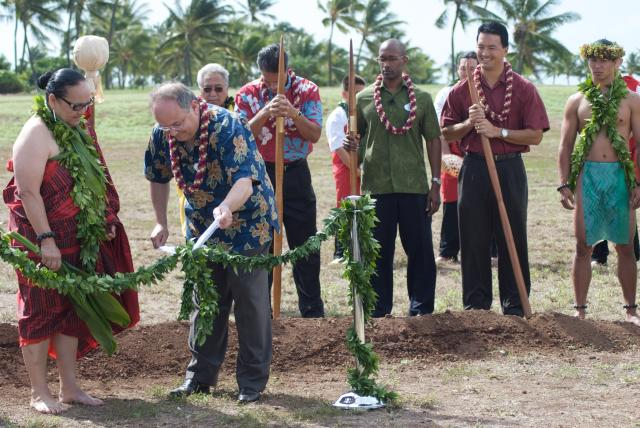 After the ground is broken, Jay Rasulo unties the ribbon of maile leaves as part of the groundbreaking ceremony for the Disney Resort at Ko Olina. Photo by Joe Philipson.